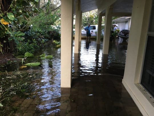 Before and after the flooding at Betsy Burdette's home on Shady River Lane.