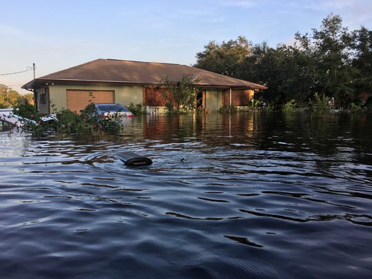 Tina Newman's home, which she says is the highest on the block, still flooded after Hurricane Irma.