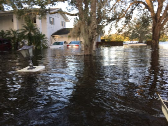The Henry family lost both cars and almost all of their belongings to the floods.