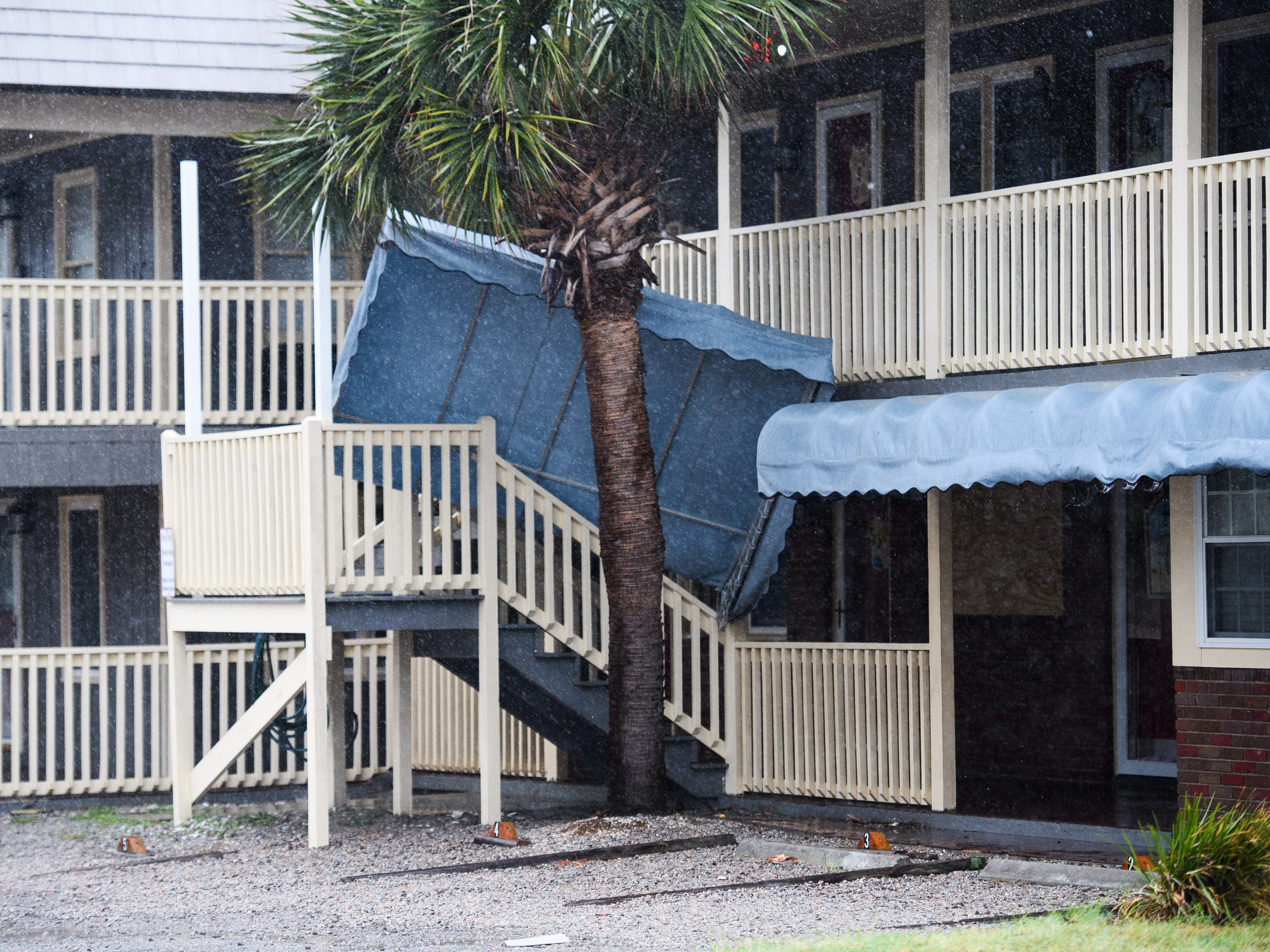 An apartment canopy is knocked down due to strong winds in North Myrtle Beach as Hurricane Florence continues its path towards South Carolina on Friday, Sept. 14, 2018.