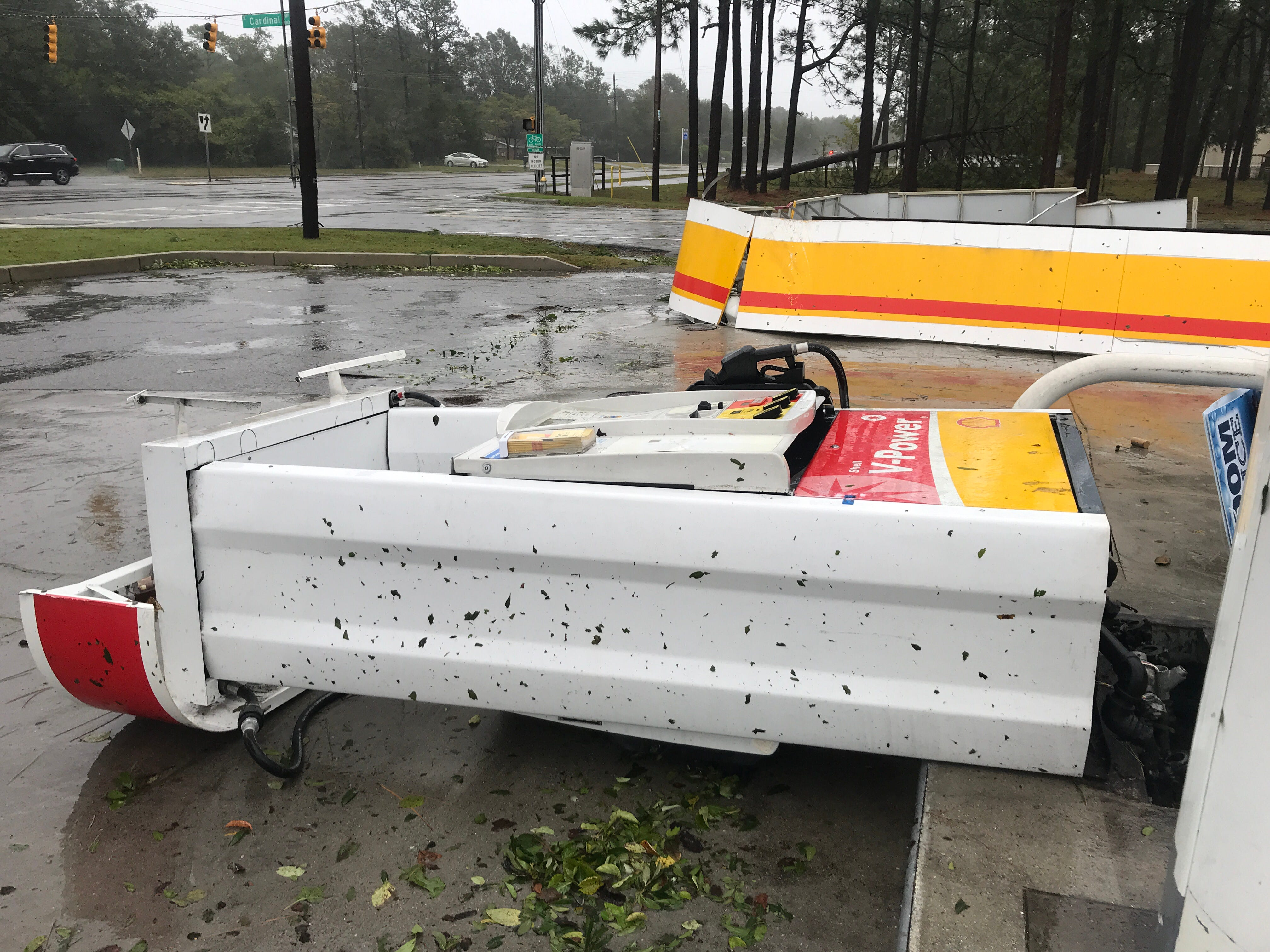 A Shell gas station on State Highway 74, a route from Wilmington to Wrightsville Beach, lost part of its roof and knocked over a pump during Hurricane Florence on Friday, Sept. 14, 2018.