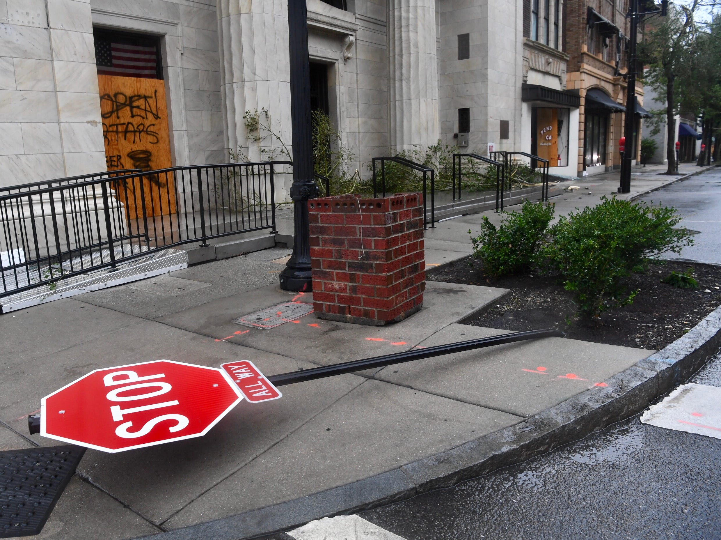 A damaged traffic sign in deserted downtown Wilmington, North Carolina, on Friday, Sept. 14, 2018, following Hurricane Florence's landfall.