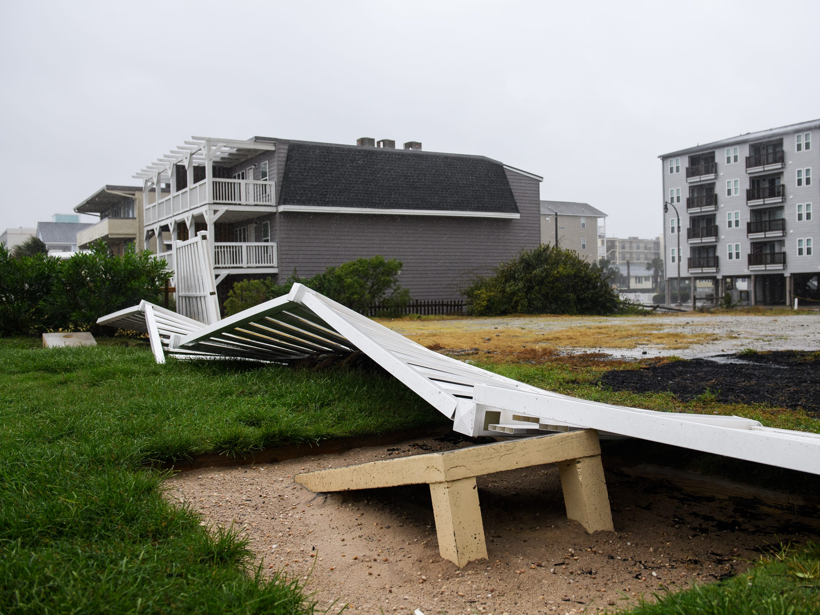 Fencing sits on the ground after being knocked over by strong winds as Hurricane Florence continues its slow path towards the North Myrtle Beach area on Friday, Sept. 14, 2018.
