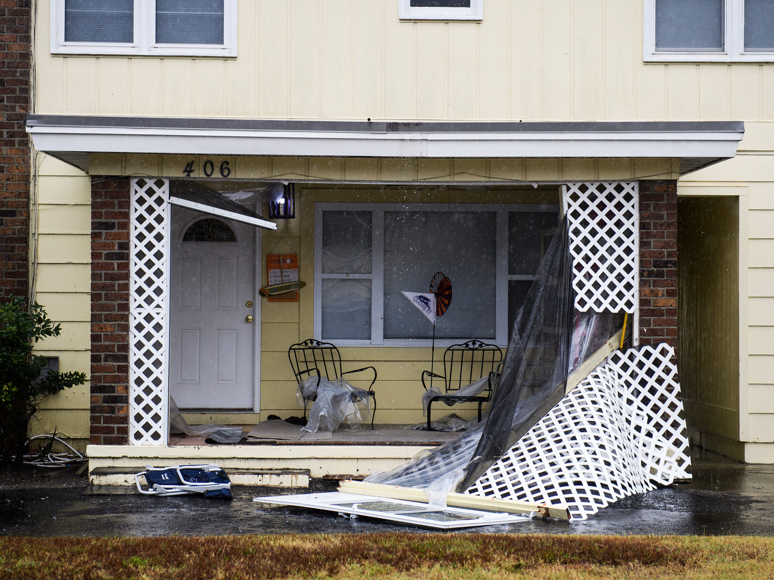 The sun room of a residence is exposed due to high winds from Hurricane Florence in North Myrtle Beach on Friday, Sept. 14, 2018.