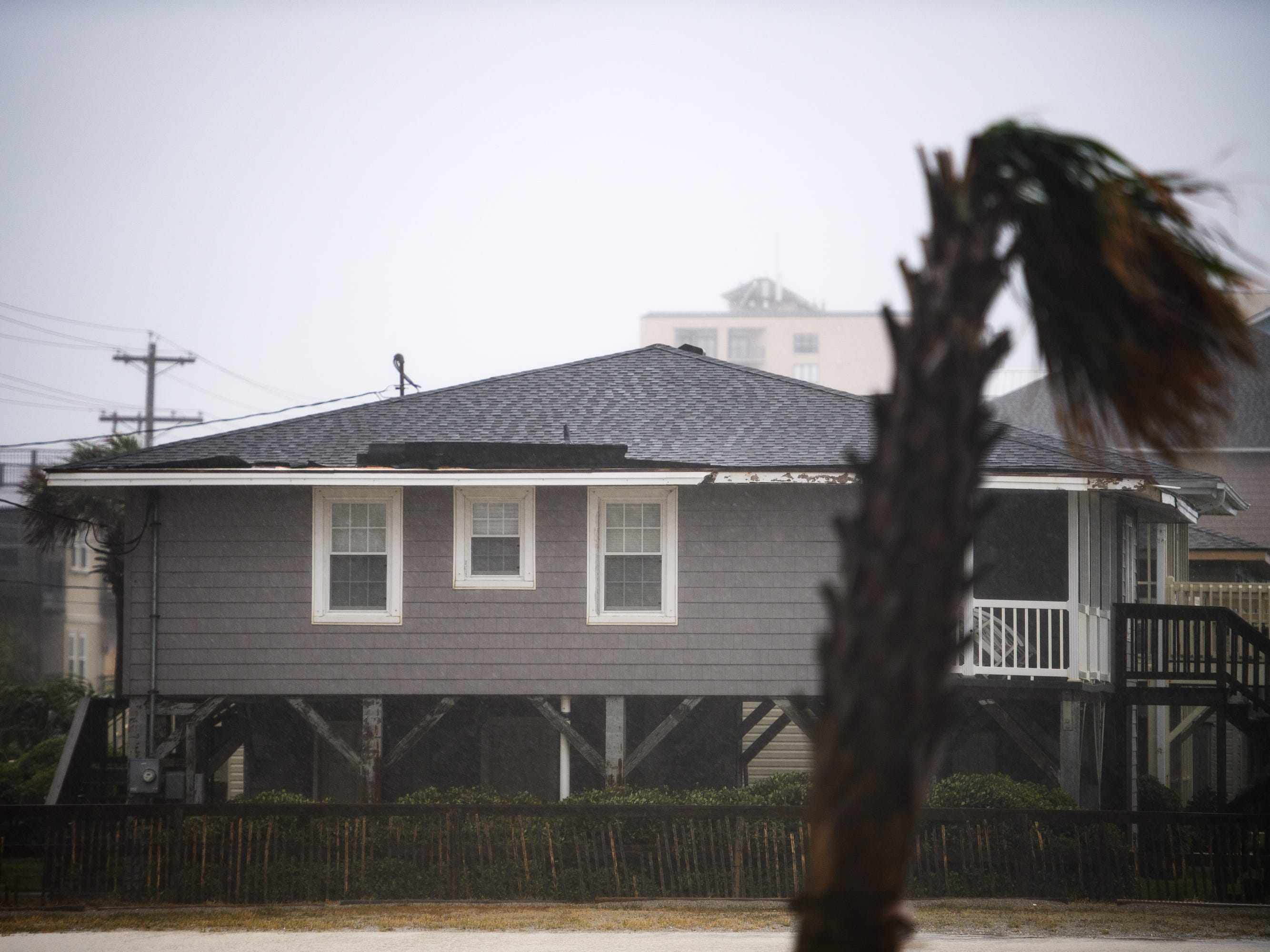 The roof of a home begins to peel off as wind speeds dramatically increase from Hurricane Florence in North Myrtle Beach on Friday, Sept. 14, 2018.