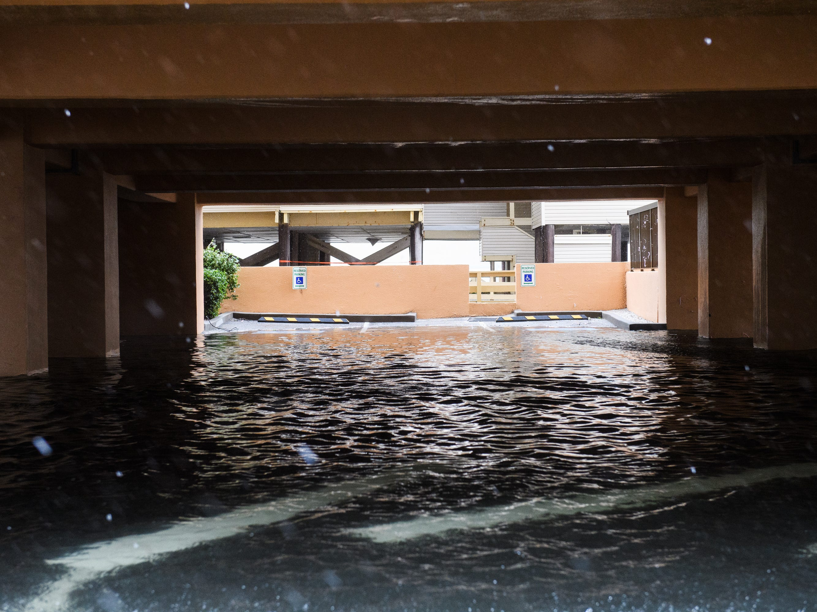 A parking structure near the ocean is flooded due to Hurricane Florence in North Myrtle Beach on Friday, Sept. 14, 2018.