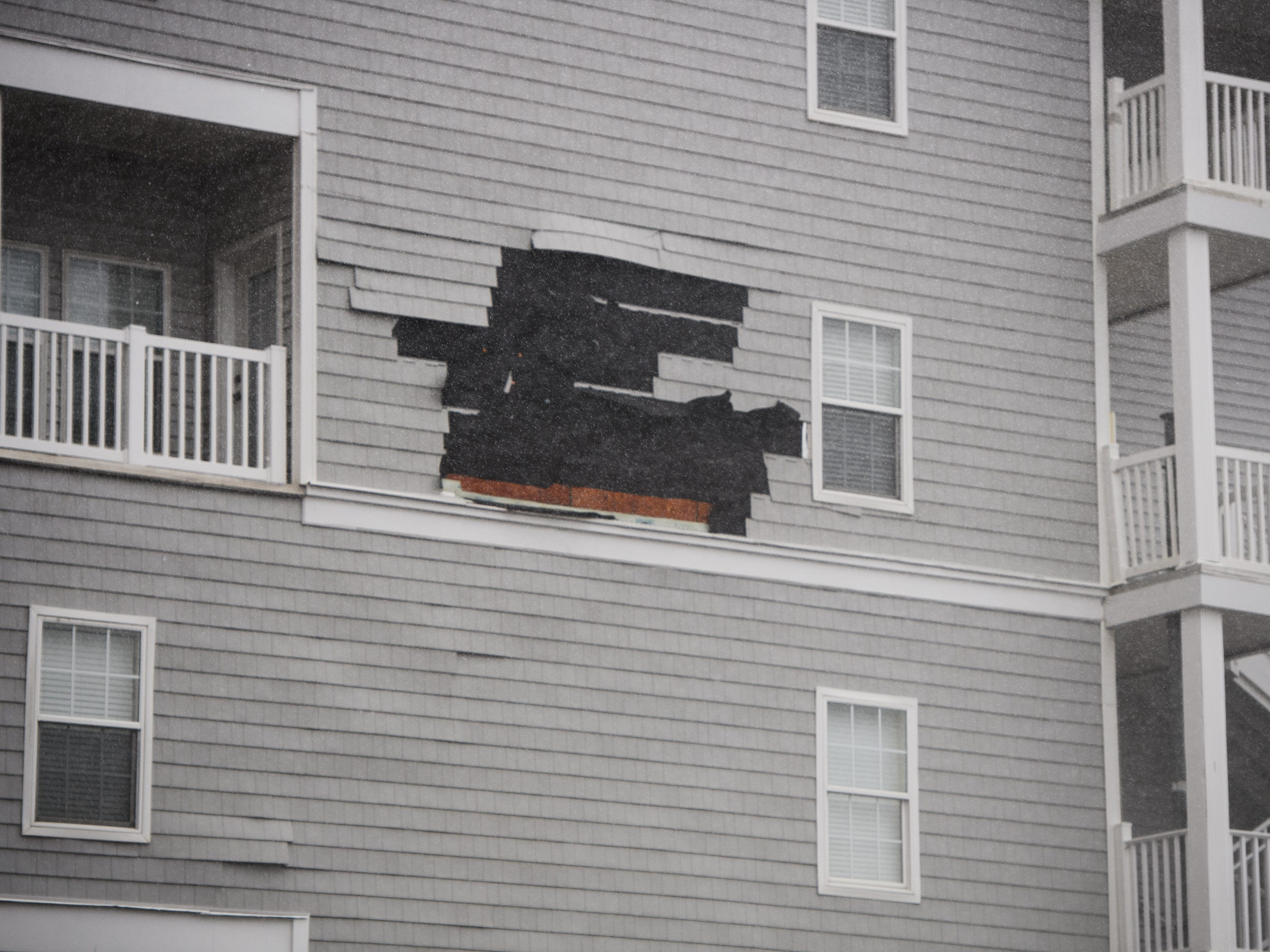 The siding of a structure begins to peel off as wind speeds dramatically increase from Hurricane Florence in North Myrtle Beach on Friday, Sept. 14, 2018.