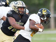 Greer defensive end Jakyre Kerns, left, investigated after receiving a scholarship offer from what appeared to be a coach at a prestigious Division I football program. With help from a Greer assistant coach, he learned that the offer was a hoax.