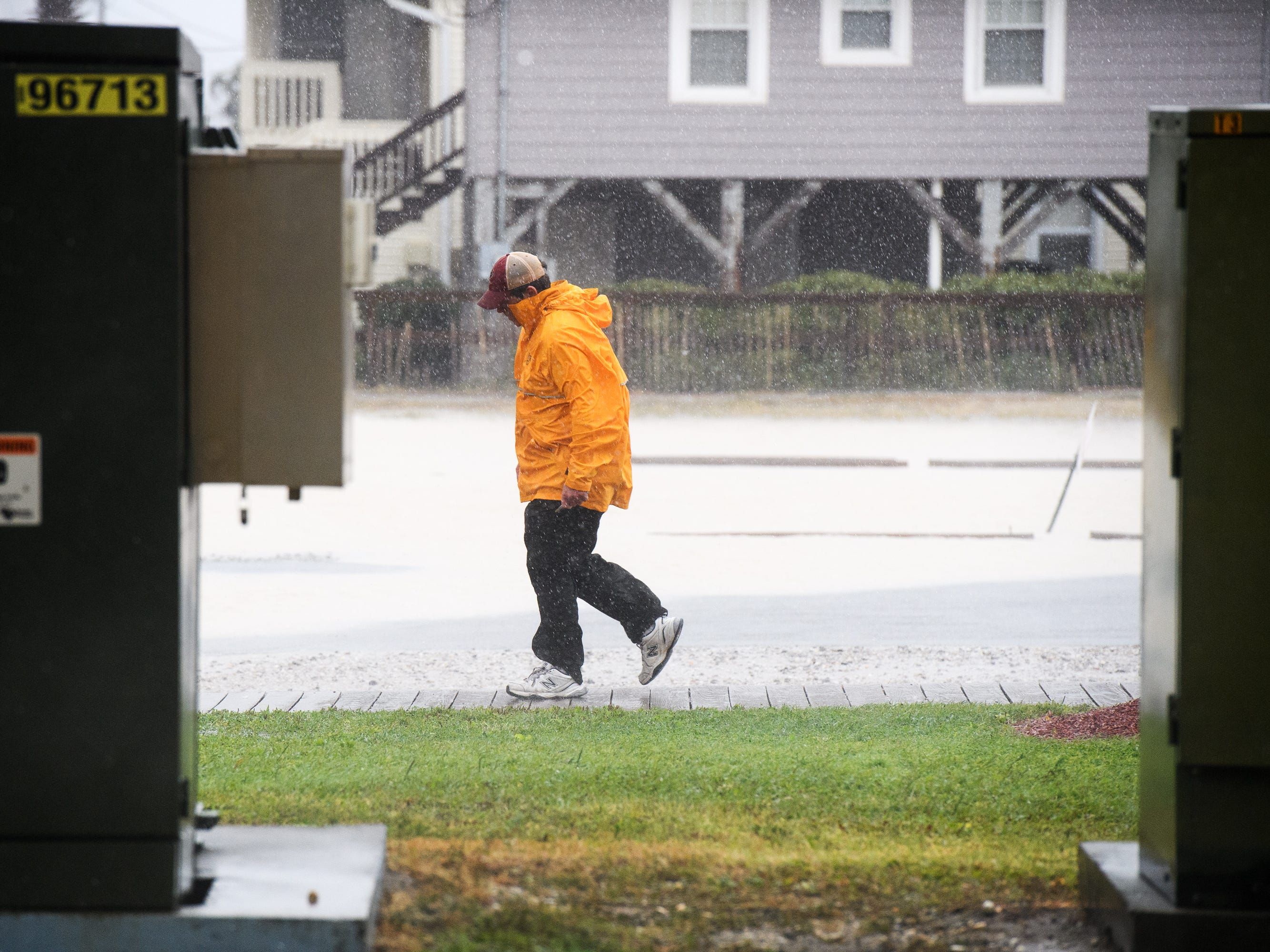 Steve Mann, operational manager for the Cherry Grove Pier, walks in a parking lot near the pier in North Myrtle Beach as wind and rain from Hurricane Florence begins to dramatically increase on Friday, Sept. 14, 2018.