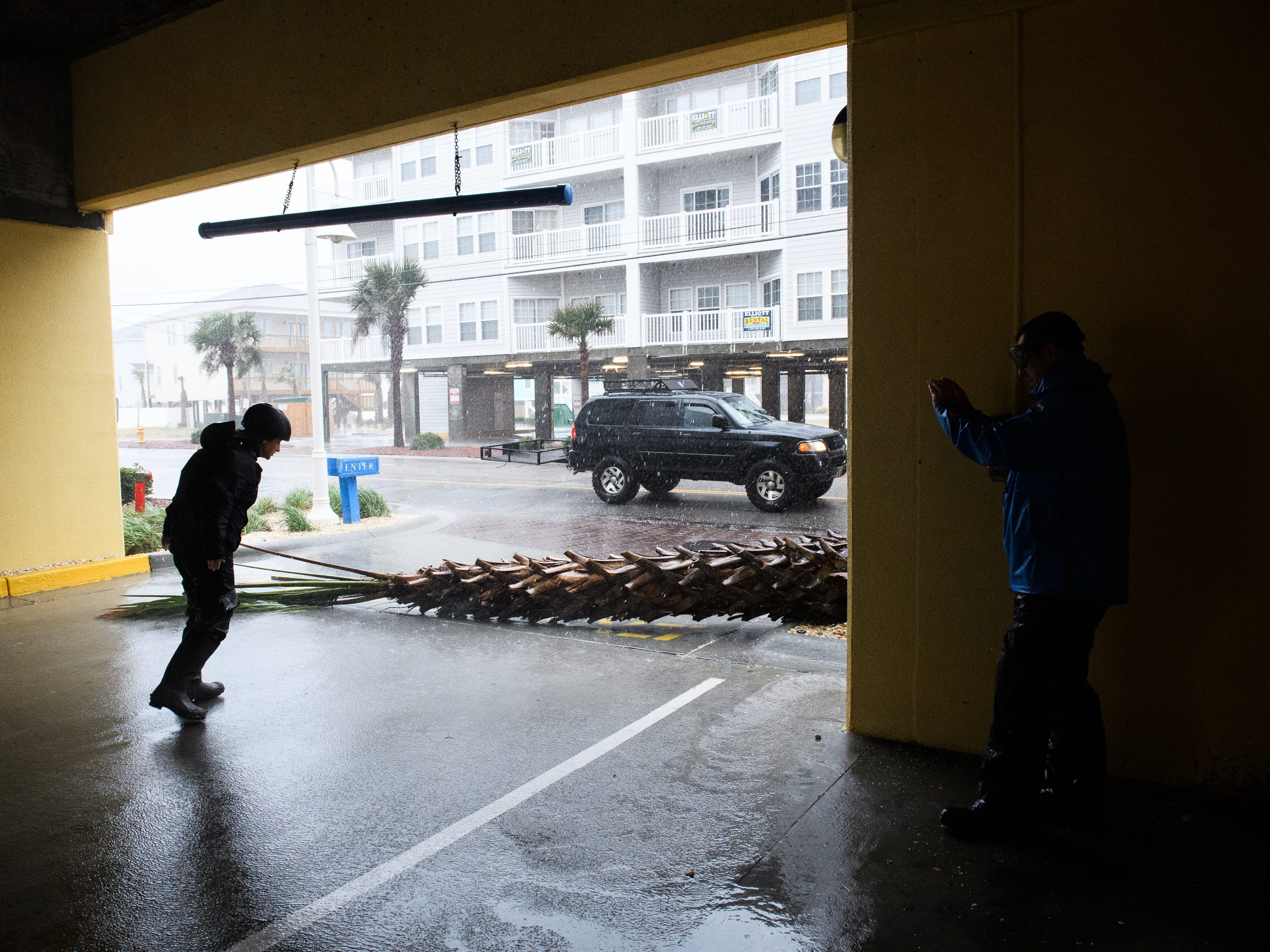 Emily Pike, a storm chaser, sees how long the wind can keep her afloat as storm conditions from Hurricane Florence worsen in North Myrtle Beach on Friday, Sept. 14, 2018.