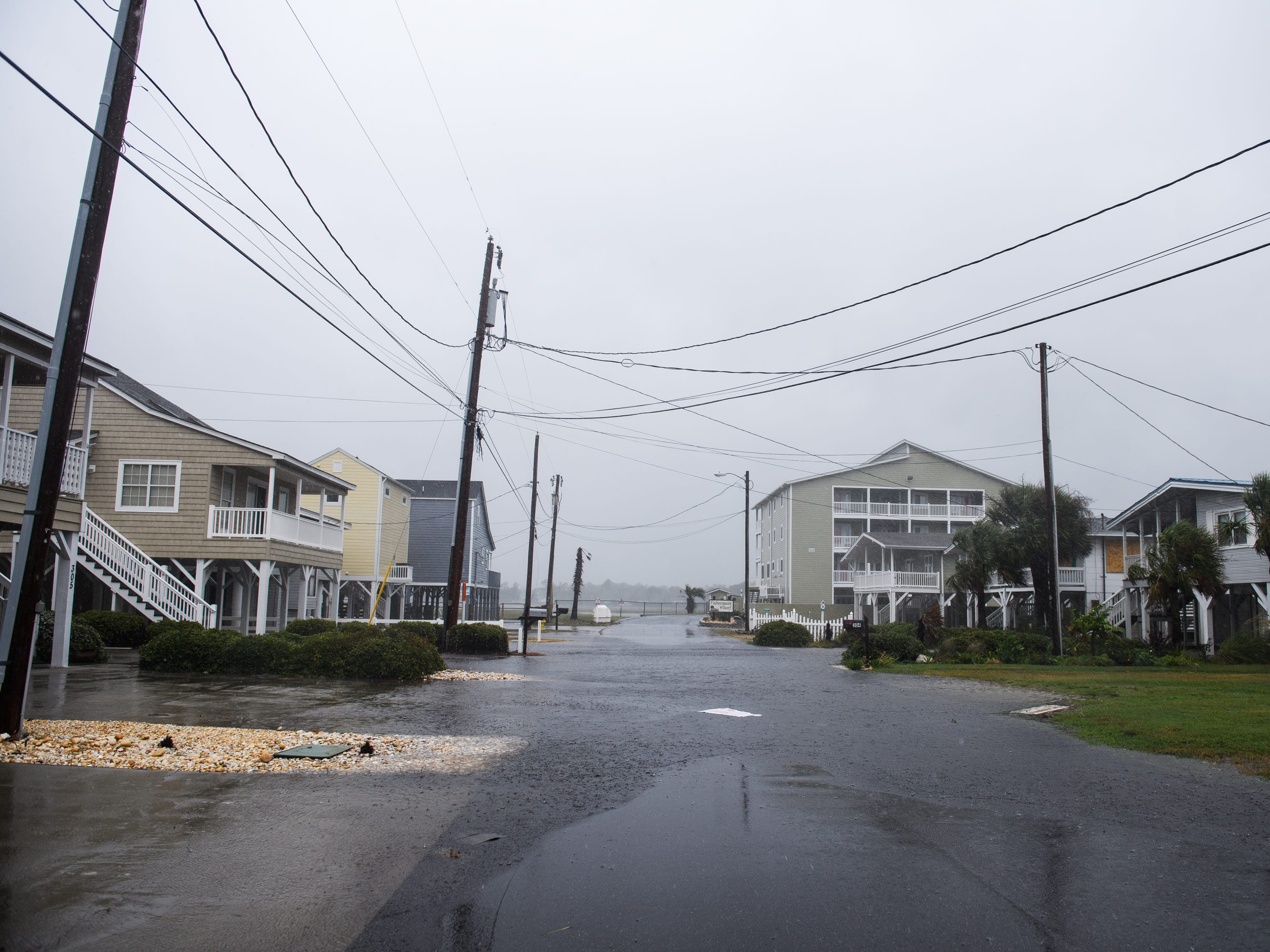 A residential street begins to flood from Hurricane Florence rainfall in North Myrtle Beach on Friday, Sept. 14, 2018.
