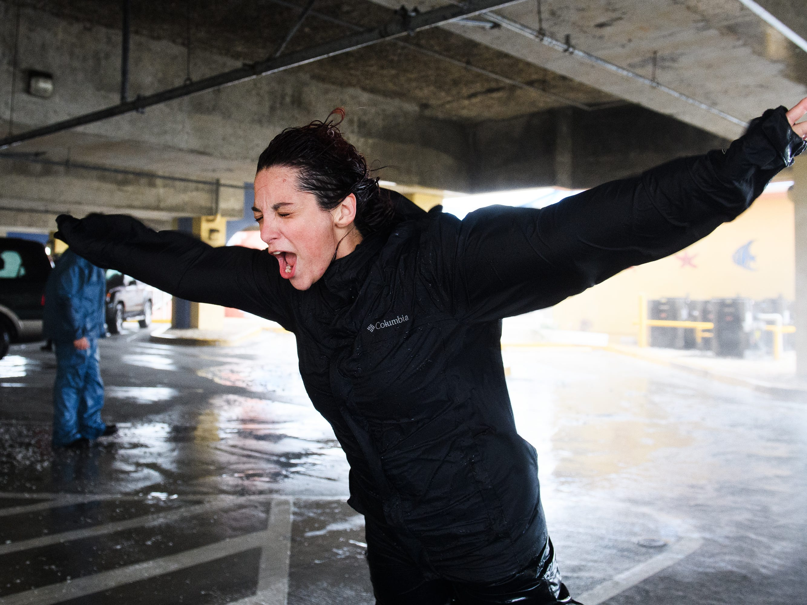 Emily Pike yells as she faces the wind caused by Hurricane Florence in a North Myrtle Beach parking garage on Friday, Sept. 14, 2018.