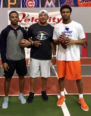 Ramon Robinson (center) has been training quarterbacks Shai Werts (left) and Kelly Bryant (right) for several years.