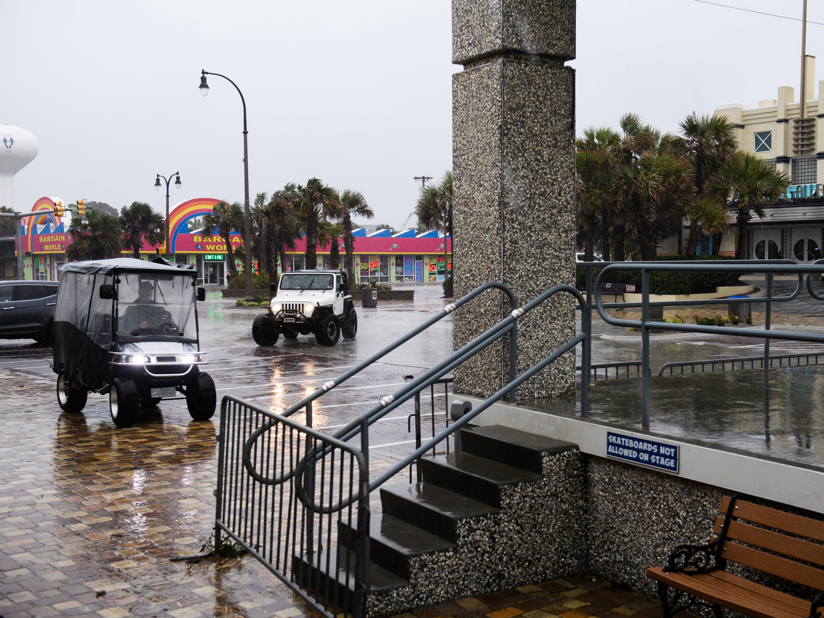 North Myrtle Beach residents check out storm conditions at the beach as Hurricane Florence inches towards South Carolina on Friday, Sept. 14, 2018.