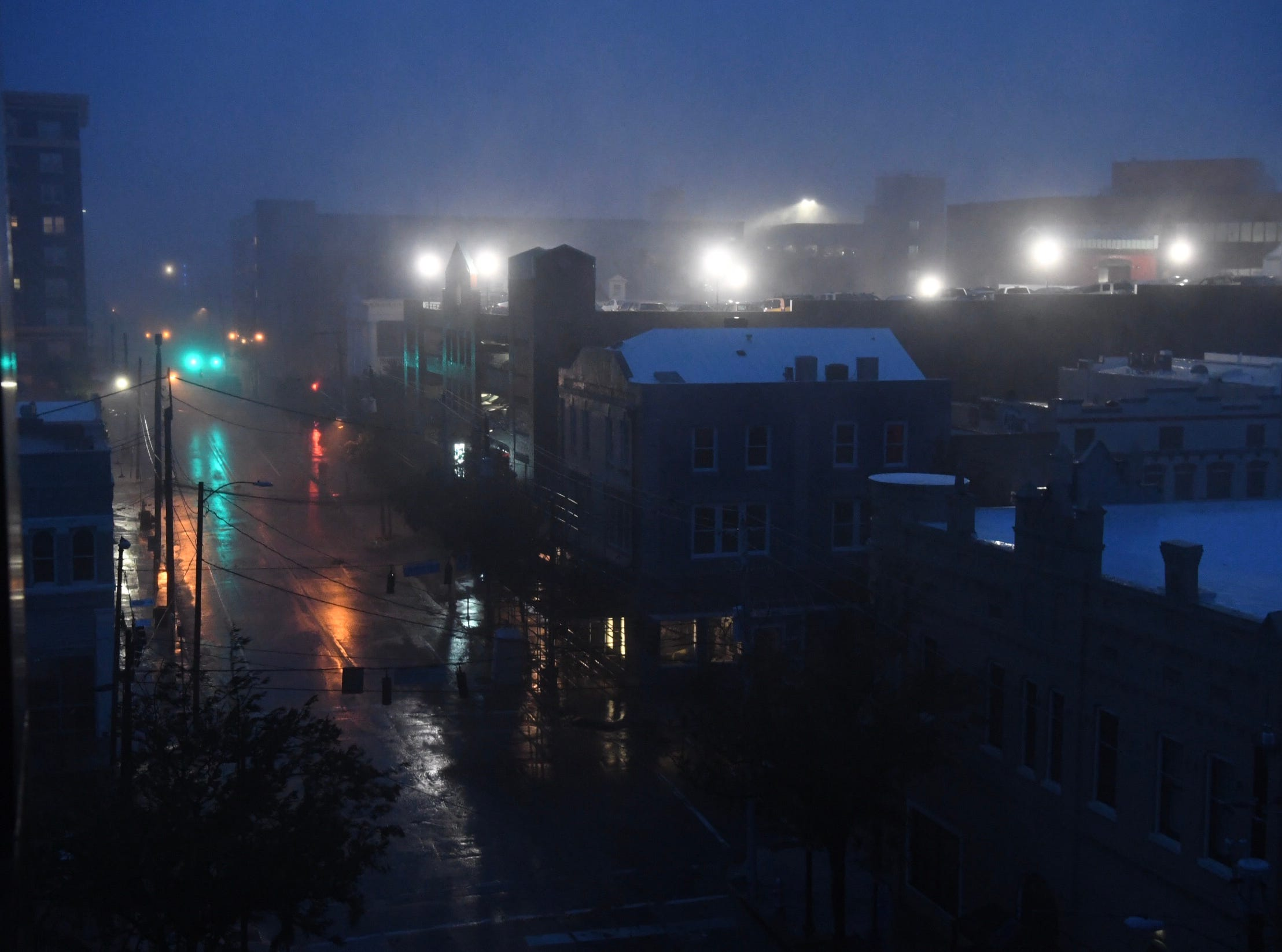 The streets of Wilmington, North Carolina, were expectedly deserted awaiting Hurricane Florence's arrival on Friday, Sept. 14, 2018. Strong winds and sheets of rain fell on the this coastal town.