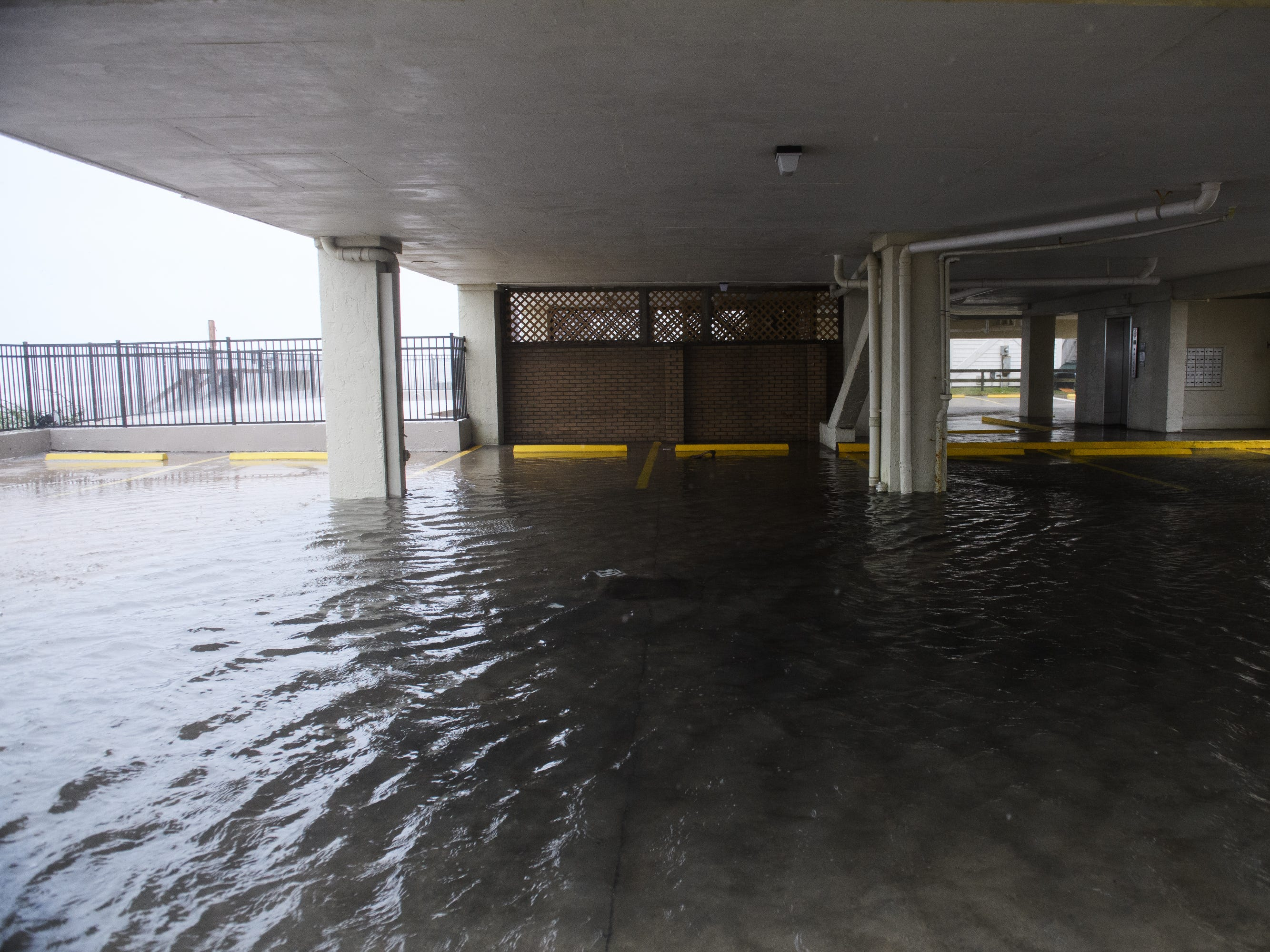A parking structure under a high rise is flooded due to Hurricane Florence rainfall in North Myrtle Beach on Friday, Sept. 14, 2018.