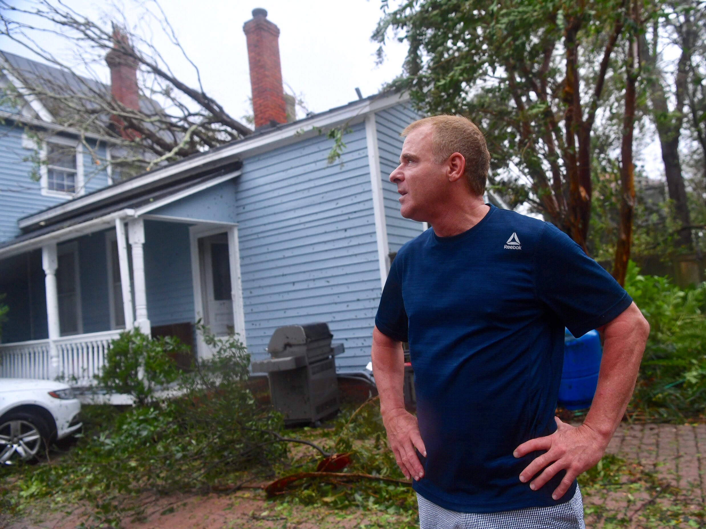 Charles Carver of Wilmington looks at his house with a tree on it and his yard as Hurricane Florence comes through Friday, Sept. 14, 2018.