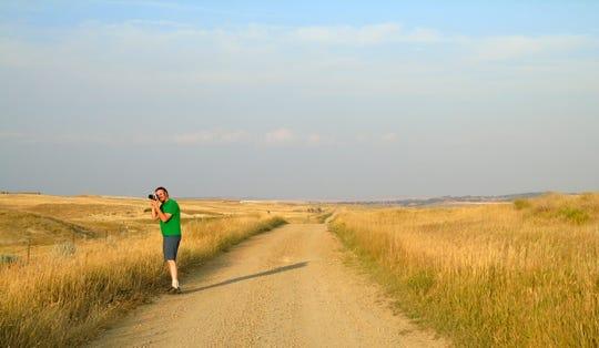 Sean R. Heavey photographs a deer along the Missouri Breaks of Montana.
