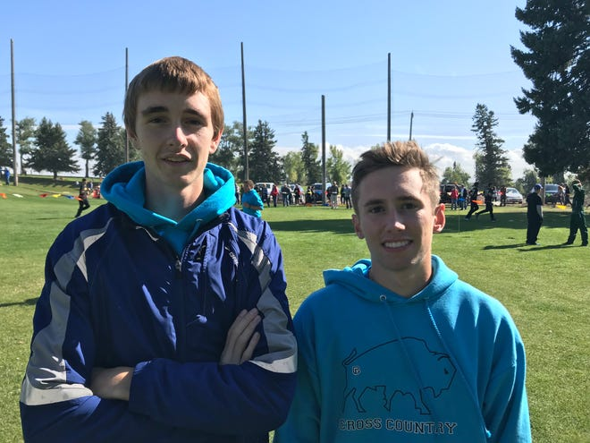 Great Falls High's Henry Kakalecik, left, and Ryan Munsterteiger, pictured after a cross country meet, will be two long distance runners on a strong Bison track team this spring.