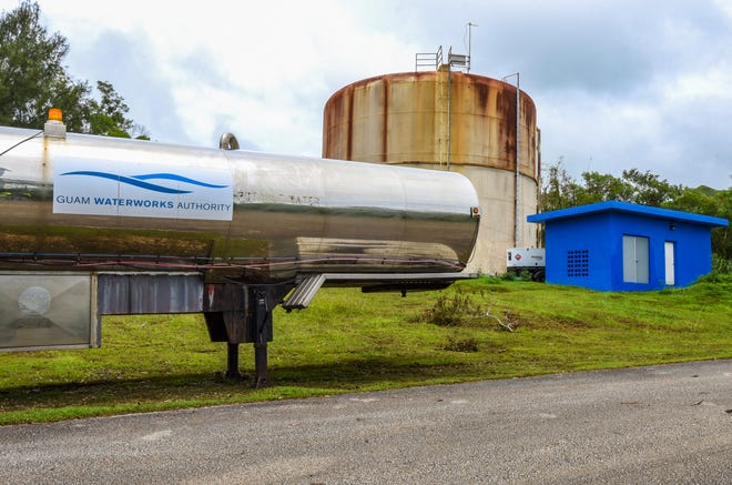 A Guam Waterworks Authority water tanker is seen positioned near the water reservoir tank in the Pigua Subdivision of Malesso on Friday, Sept. 14, 2018. The tanker, and another placed in Agat, were made available to provide potable water to area residents experiencing water outages because the reservoir tanks were reported to have been lacking power or back-up generators to energize booster pumps that distributes water to people living at the higher elevations.