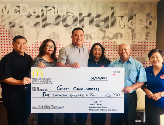 Guam Crime Stoppers board received a $5000 donation from McDonald's for the third annual annual golf tournament sponsorship Sept. 5. Pictured from left: Guam Crime Stoppers board treasurer Wayne Santos, board member Doris Ann Quichocho, board member Richard Ybanez, board secretary Sallie McDonald, McDonald's of Guam president and owner operator Jose C. Ayuyu, Guam Crime Stoppers vice chair Divina Evaristo. The golf tournament sponsorship is part of the company's continuing efforts to fight crime in their communities.