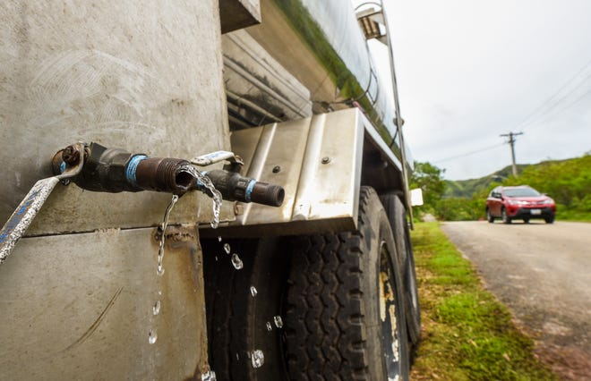 Water drips from a partially closed valve on a Guam Waterworks Authority water tanker positioned near a GWA water reservoir tank in the Pigua Subdivision of Malesso on Friday, Sept. 14, 2018. The tanker, and another placed in Agat, were made available to provide potable water to area residents experiencing water outages because the reservoir tanks were reported to have been lacking power or back-up generators to energize booster pumps that distributes water to people living at the higher elevations.