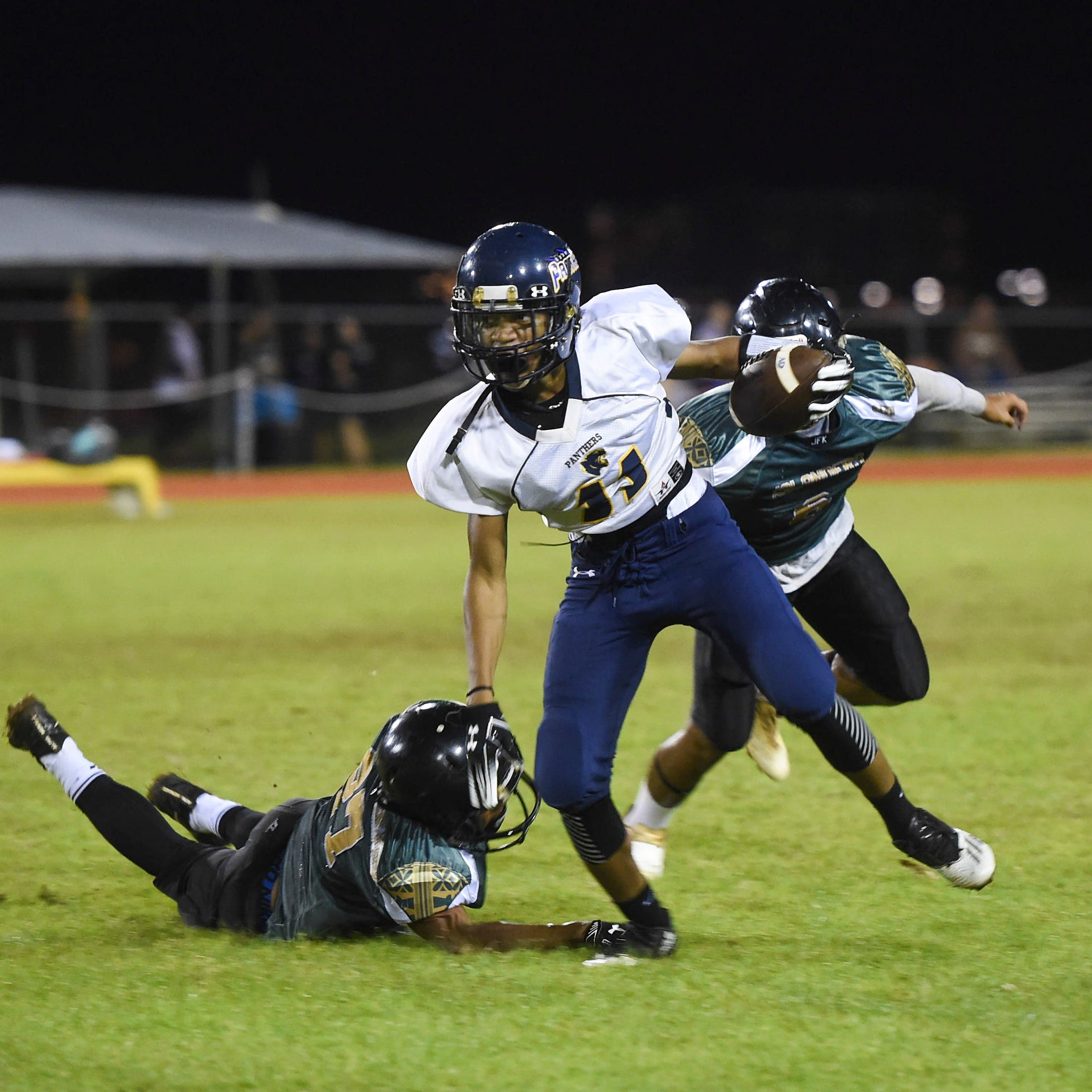 Guam High Panthers edge JFK Islanders in OT, 13-6