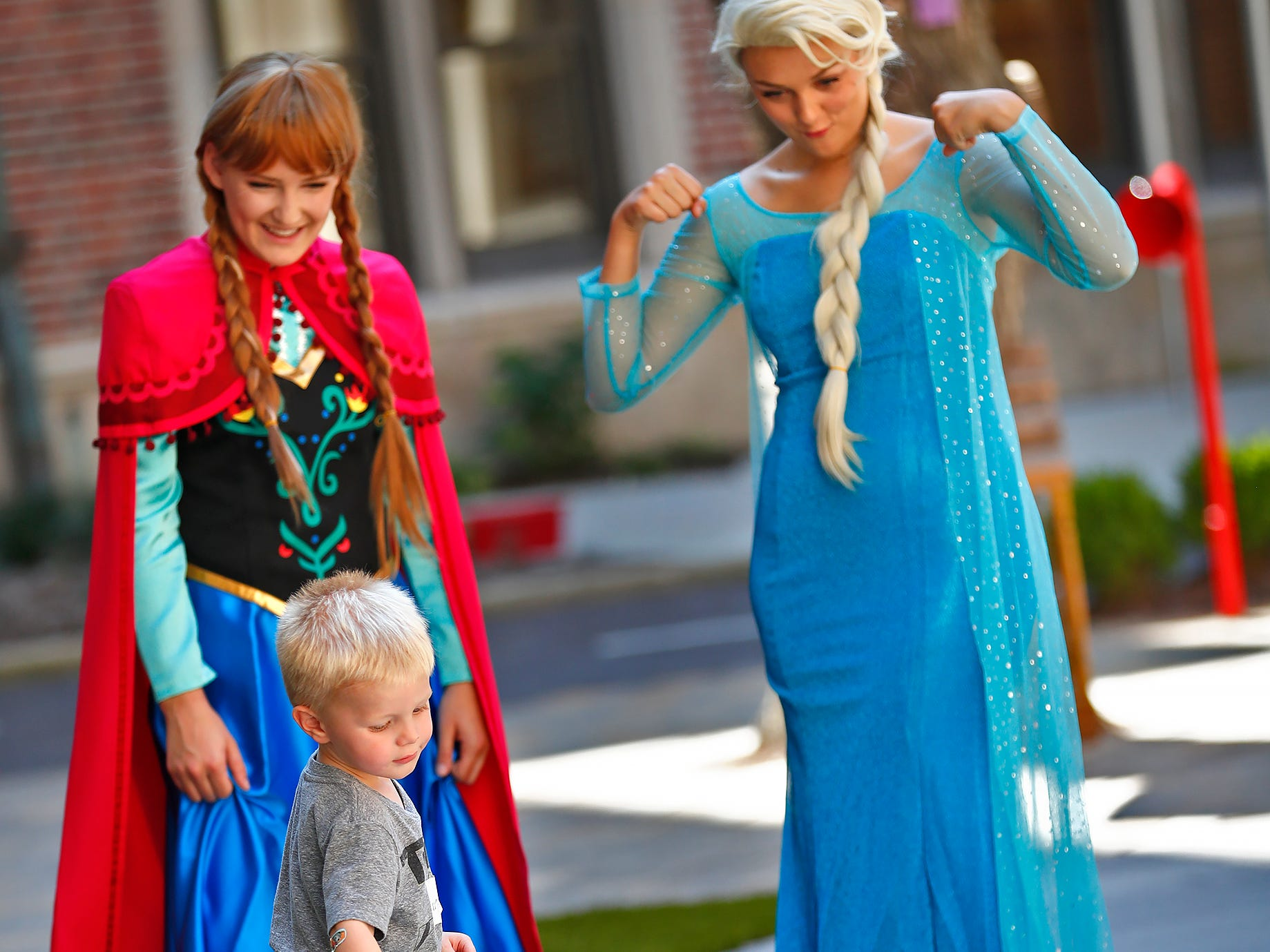 """Anna,"" Emily Boehm, left, and ""Elsa,"" Emily Greggs, both characters from Frozen, play with Owen Kuebler at Riley Children's Health, Friday, Sept. 13, 2018. IU students with ""Royal Encounters"" entertained patients and their families at Riley.  Princesses and a Prince, with the volunteer group, brought smiles to the kids with their visit."