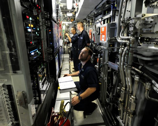 Sailors assigned to Pre-Commissioning Unit Indiana (SSN 789) perform a systems status check and simulate torpedo launch procedures on the weapons launch console while underway, June 23, 2018. Indiana is the 16th Virginia-class fast attack submarine and is scheduled to be commissioned Sept. 29, 2018.  (U.S. Navy photo by Chief Mass Communication Specialist Darryl Wood/Released)