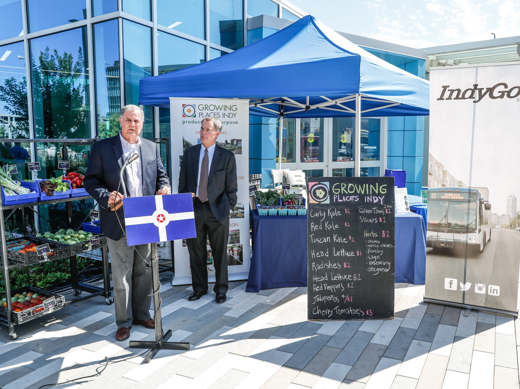 IndyGo President and CEO, Mike Terry, left, and Indianapolis Mayor Joe Hogsett, give remarks in partnership withGrowing Places Indy during the launch of the ÒFood in TransitÓ program at the Julia M. Carson Transit Center on Friday, Sept. 14, 2018. Visitors to the Transit Center can purchase produce every Friday from 3 p.m. to 6 p.m. through October 26.