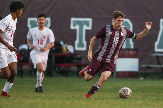 Lawrence Central Bears Max Allen (15) moves the ball away from Pike Red Devils defenders at Lawrence Central High School in Indianapolis, Thursday, Sept. 13, 2018. Lawrence Central won on the team's senior night, 2-1.