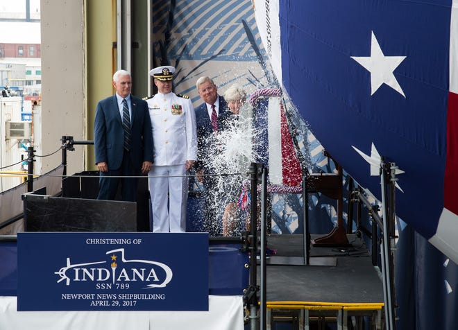 Ship's Sponsor Diane Donald christens the Virginia-class submarine Indiana (SSN 789), witnessed by (from left) Vice President Mike Pence, Indiana's  Commanding Officer, Cdr. Jesse Zimbauer and Newport News Shipbuilding President Matt Mulherin.