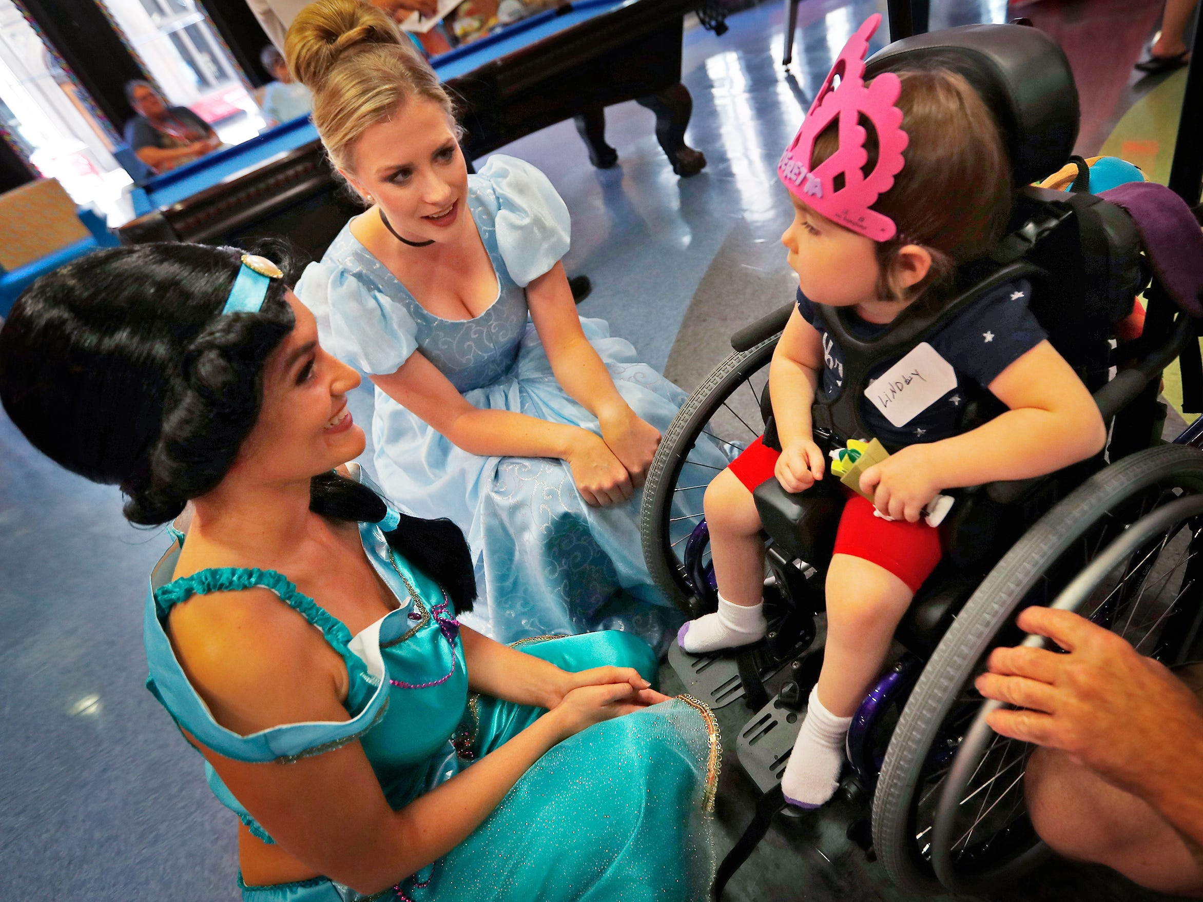 "Lindly Hatfield, right, visits with ""Jasmine,"" Hannah Cotter, from left, and ""Cinderella,"" Haley Sample, at Riley Children's Health, Friday, Sept. 13, 2018. IU students with ""Royal Encounters"" entertained patients and their families at Riley.  Princesses and a Prince, with the volunteer group, brought smiles to the kids with their visit."