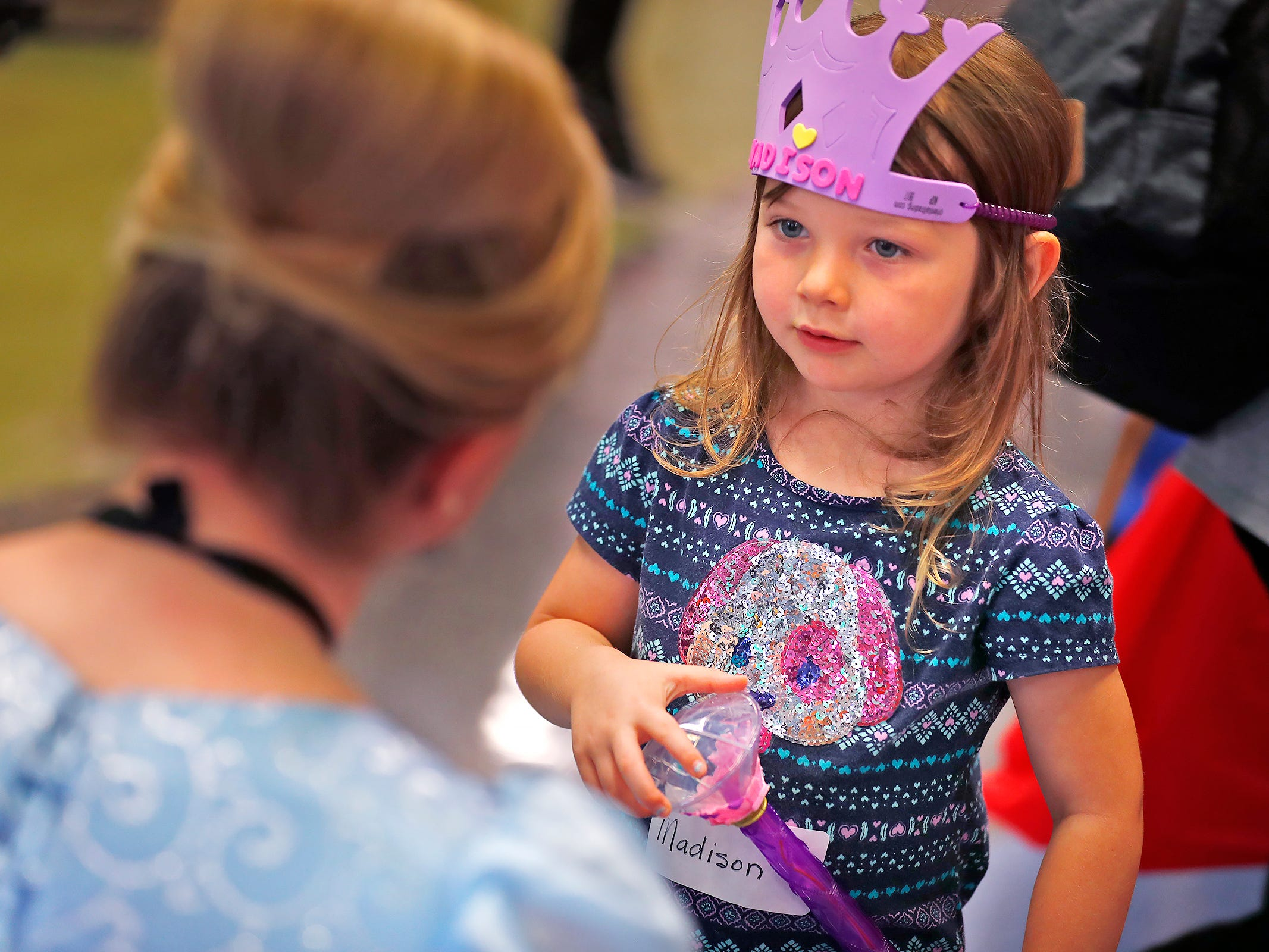 "Madison Tanner, right, talks with ""Cinderella,"" Haley Sample, at Riley Children's Health, Friday, Sept. 13, 2018.  IU students with ""Royal Encounters"" entertained patients and their families at Riley.  Princesses and a Prince, with the volunteer group, brought smiles to the kids with their visit."