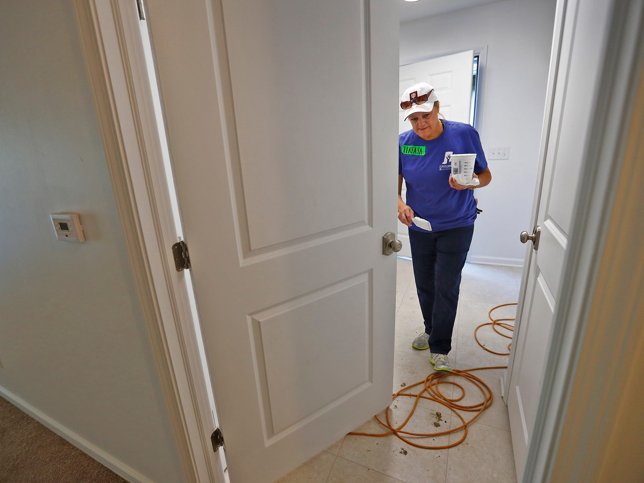 Tereasa Gillentine checks for spots to retouch with paint in a home, during the 10th Annual IU Health Day of Service, Friday, Sept. 13, 2018.  IU Health team members donated time and effort building and finishing a Habitat for Humanity home in the 3700 block of Kenwood Ave. For 22 days, with partner volunteers, over 250 members of the IU Health team have donated more than 1680 hours at the house that will become the new home for the Ndatira family.