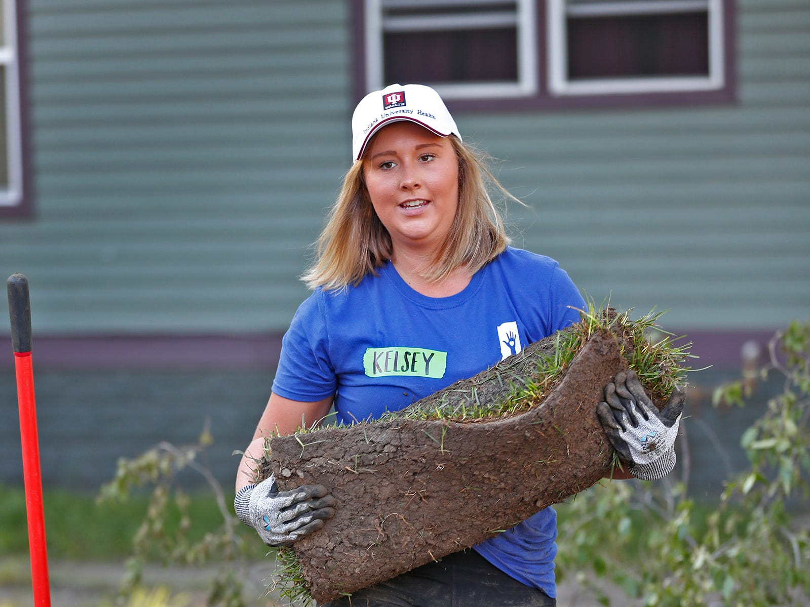 Kelsey Miller carries sod to place on the front lawn of a home  during the 10th Annual IU Health Day of Service, Friday, Sept. 13, 2018.  IU Health team members donated time and effort building and finishing a Habitat for Humanity home in the 3700 block of Kenwood Ave. For 22 days, with partner volunteers, over 250 members of the IU Health team have donated more than 1680 hours at the house that will become the new home for the Ndatira family.