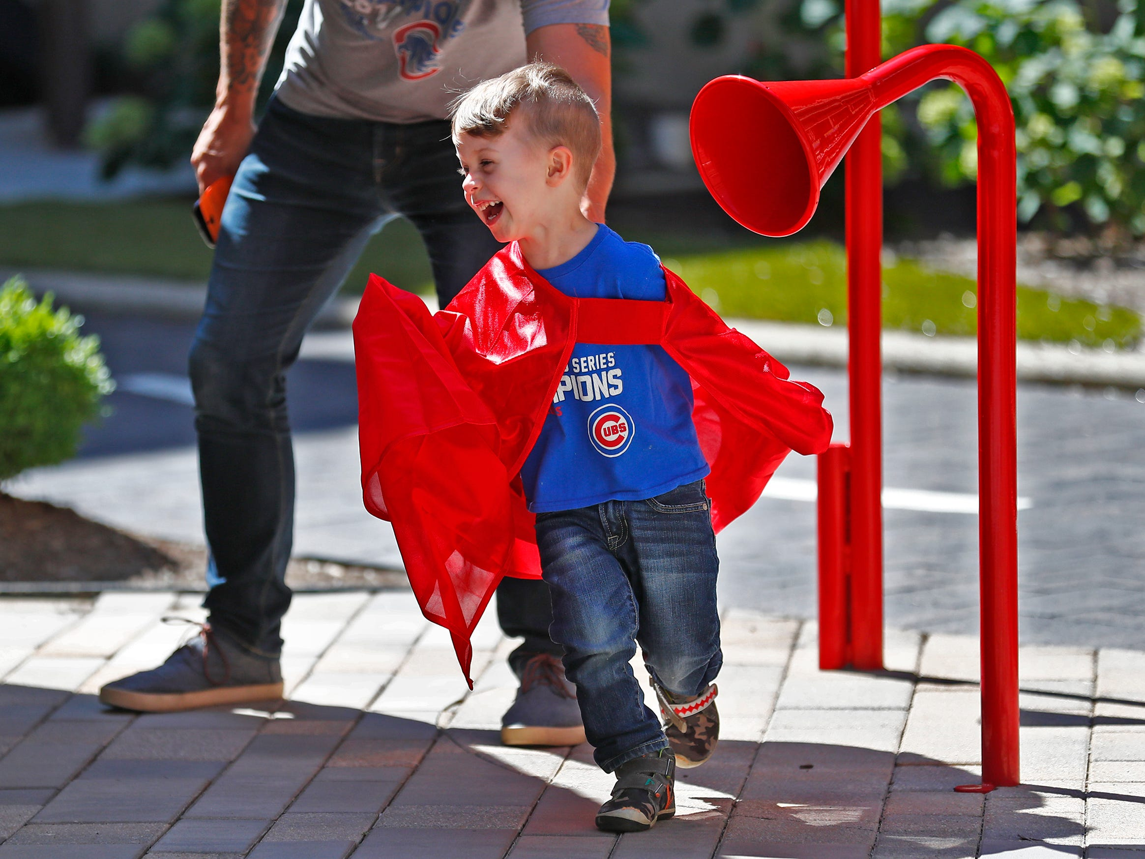 """Super Hero"" Max Jurijczuk wears a cape while playing at Riley Children's Health, Friday, Sept. 13, 2018.  IU students with ""Royal Encounters"" entertained patients and their families at Riley.  Princesses and a Prince, with the volunteer group, brought smiles to the kids with their visit, and turned some of the kids into superheroes."