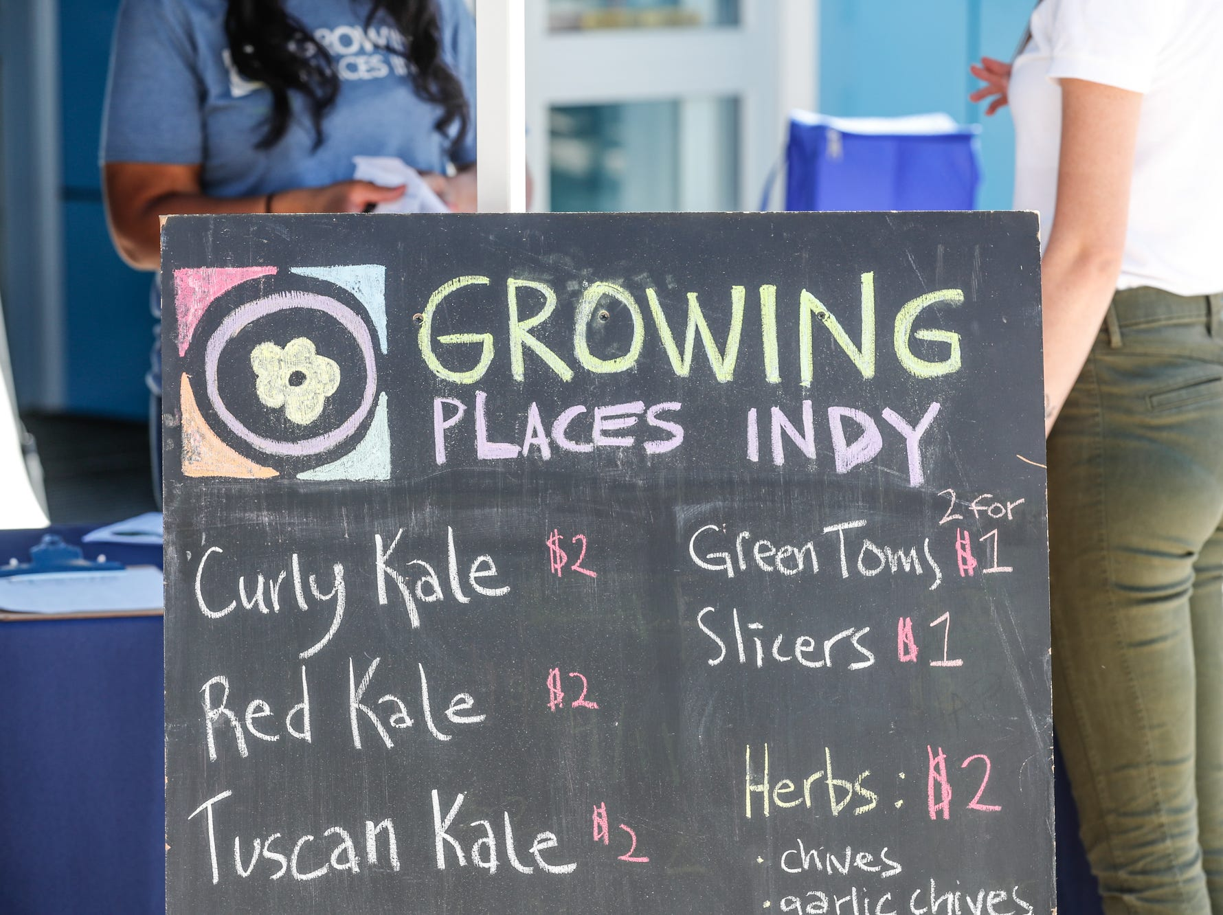 Fresh produce is listed with prices at the Julia M. Carson Transit Center through the ÒFood in TransitÓ program on Friday, Sept. 14, 2018. Indianapolis Mayor Joe Hogsett, in partnership with IndyGo and Growing Places Indy, launched the ÒFood in TransitÓ program. Visitors to the Transit Center can purchase produce every Friday from 3 p.m. to 6 p.m. through October 26.