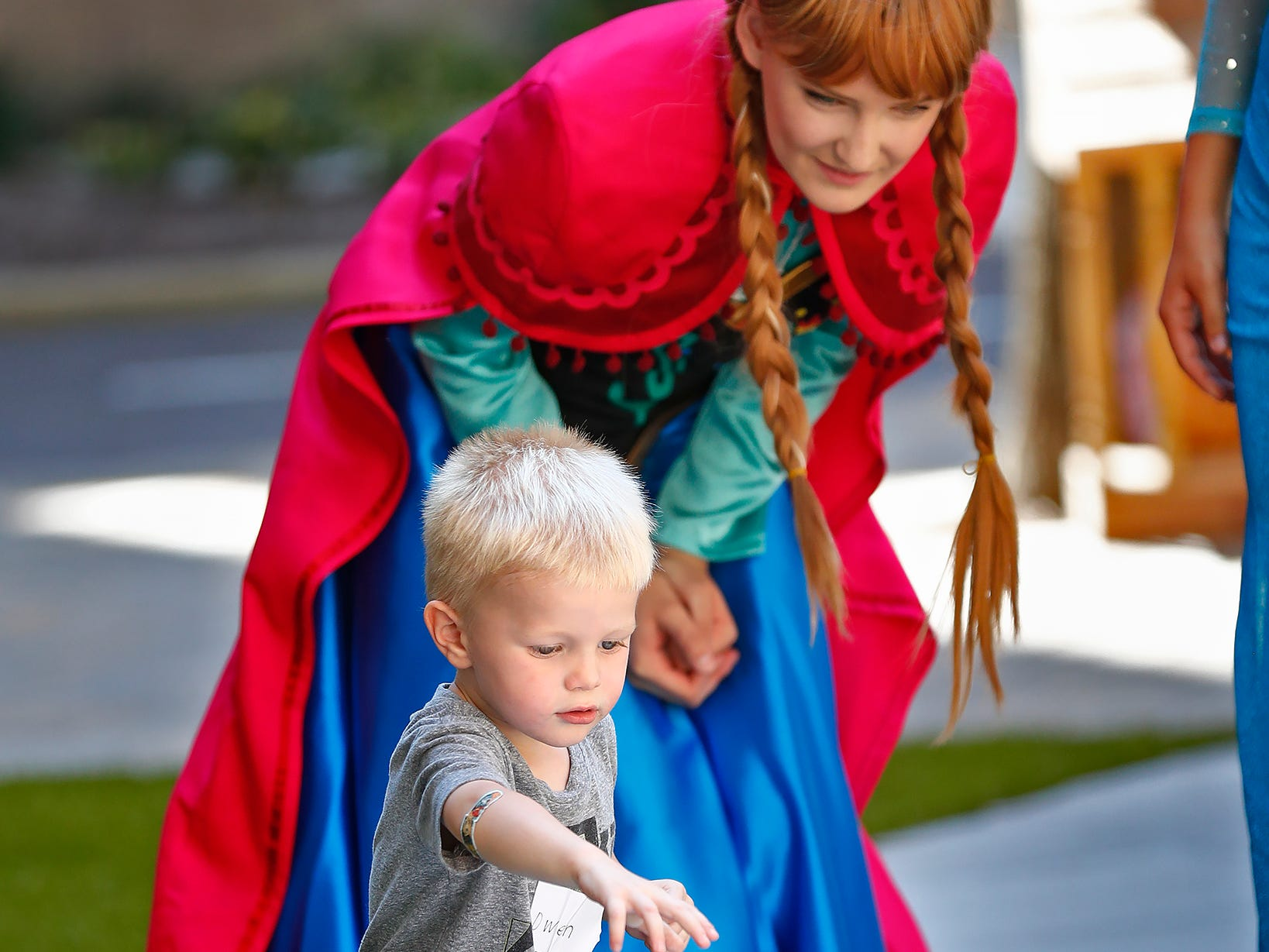"""Anna,"" Emily Boehm, from Frozen, plays with Owen Kuebler at Riley Children's Health, Friday, Sept. 13, 2018. IU students with ""Royal Encounters"" entertained patients and their families as royalty."