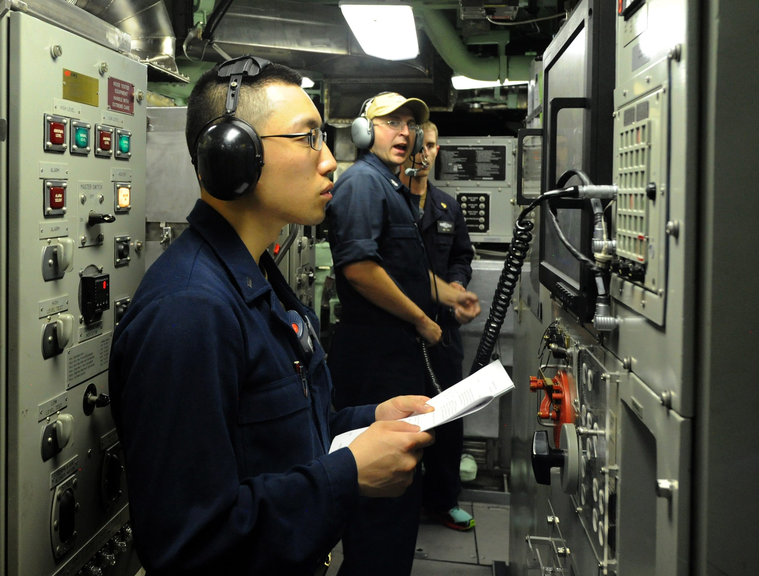 Lt. j.g. Leslie Liang performs normal diesel operation checks, verifying pressure, temperature and the operational status of the diesel engines aboard Pre-Commissioning Unit Indiana (SSN 789), June 23, 2018. Indiana is the 16th Virginia-class fast attack submarine and is scheduled to be commissioned Sept. 29, 2018. (U.S. Navy photo by Chief Mass Communication Specialist Darryl Wood/Released)