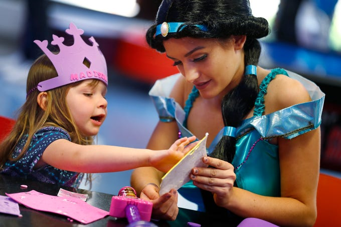"Madison Tanner, left, makes a crown with ""Jasmine,"" Hannah Cotter, at Riley Children's Health, Friday, Sept. 13, 2018. IU students with ""Royal Encounters"" entertained patients and their families at Riley.  Princesses and a Prince, with the volunteer group, brought smiles to the kids with their visit."