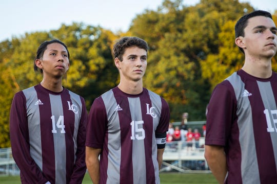 Center, Lawrence Central Bears Max Allen (15) stands with teammates for the national anthem before a match against Pike at Lawrence Central High School in Indianapolis, Thursday, Sept. 13, 2018. Lawrence Central won on the team's senior night, 2-1.
