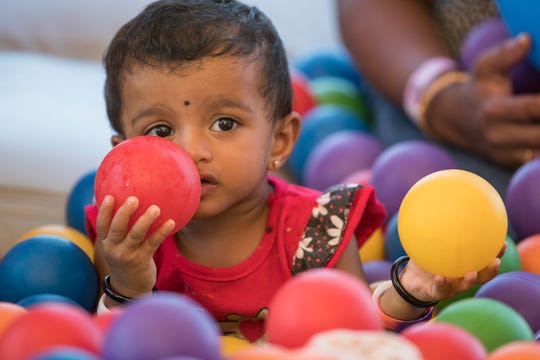 Varshini Balaji, 1, plays in the ball pit at the Big Bounce America inflatable attraction at Waterman's Family Farm in Indianapolis, Friday, Sept. 14, 2018. The world's largest bounce house covers 10,000 square feet and will be in Indy though September 16.