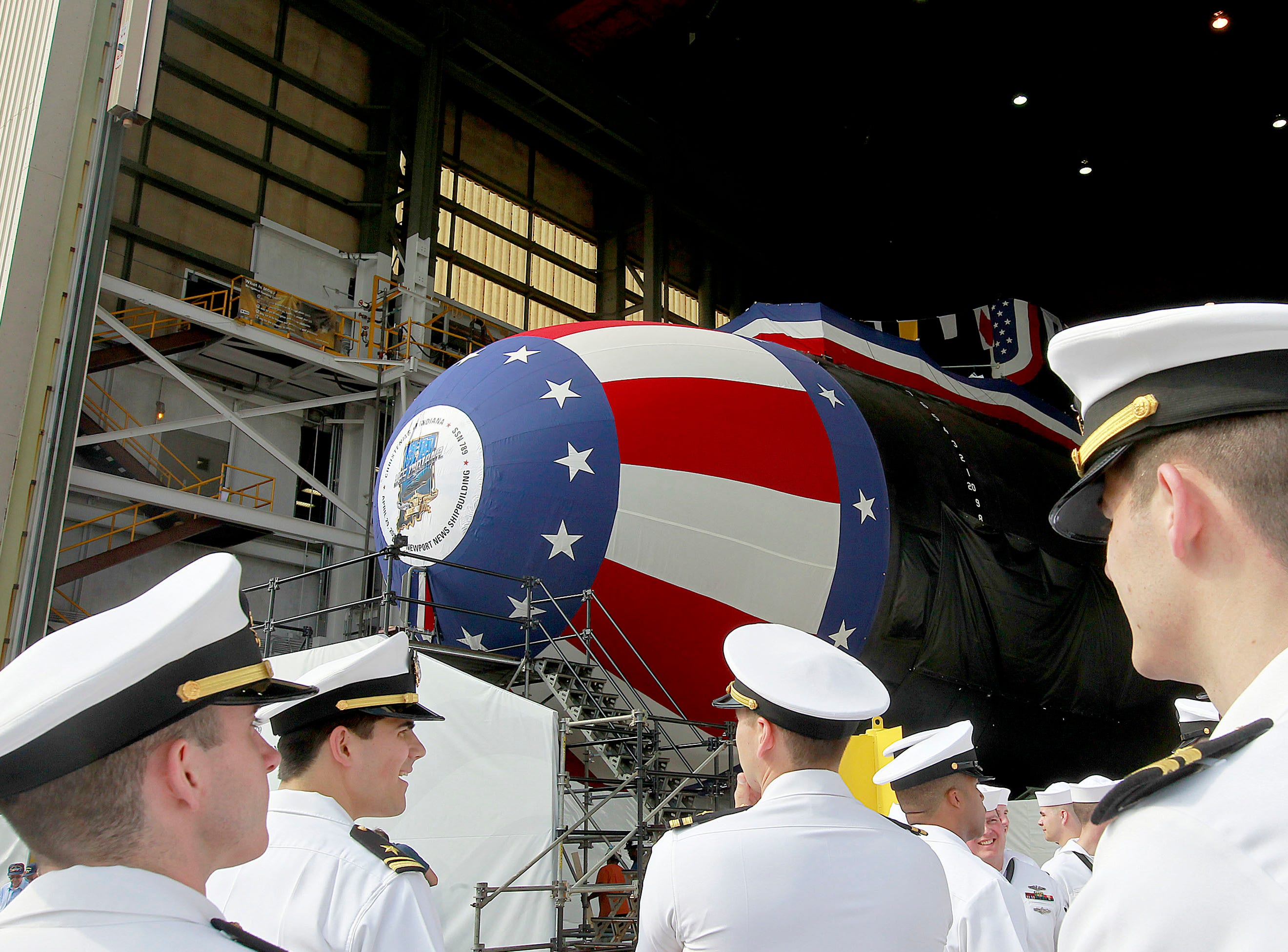Crew members of the Virginia-class submarine USS Indiana get ready for christening ceremonies Friday April 28, 2017 at Newport News Shipbuilding in Newport News, Va. The ship will be christened Saturday with a crowd of about 4000 expected along with Vice President Mike Pence.