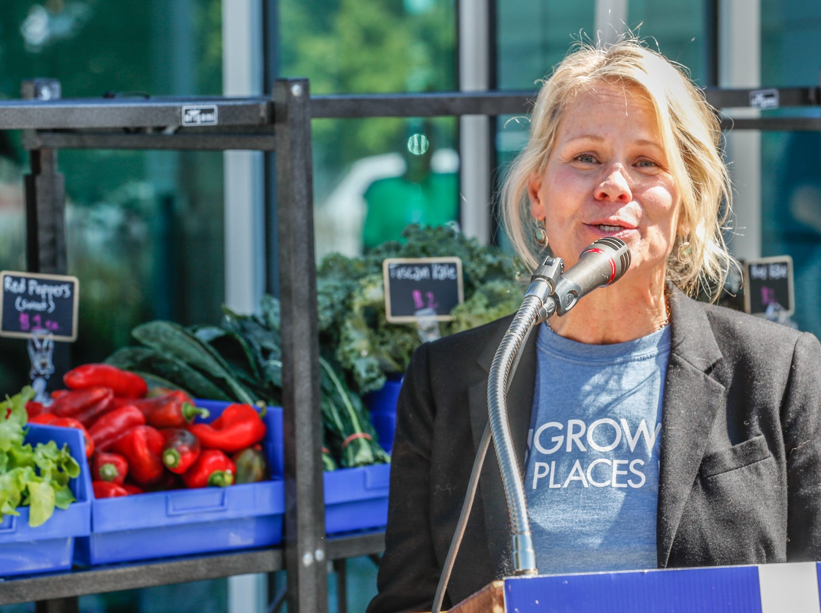 Linda Cook, executive director of Growing Places Indy, gives remarks  during the launch of the ÒFood in TransitÓ program at the Julia M. Carson Transit Center on Friday, Sept. 14, 2018. Visitors to the Transit Center can purchase produce every Friday from 3 p.m. to 6 p.m. through October 26.