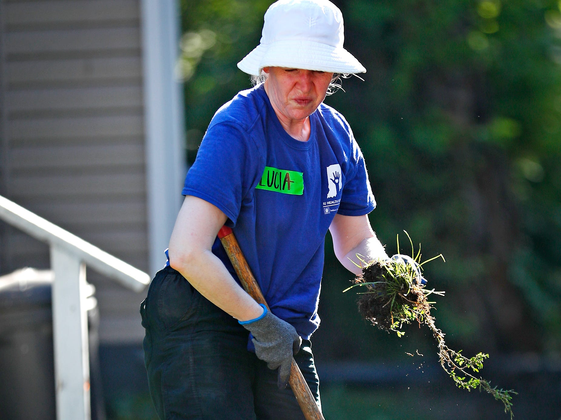 Lucia Wocial works on the front lawn landscaping of a Habitat for Humanity home, during the 10th Annual IU Health Day of Service, Friday, Sept. 13, 2018.  IU Health team members donated time and effort building and finishing a Habitat for Humanity home in the 3700 block of Kenwood Ave. For 22 days, with partner volunteers, over 250 members of the IU Health team have donated more than 1680 hours at the house that will become the new home for the Ndatira family.