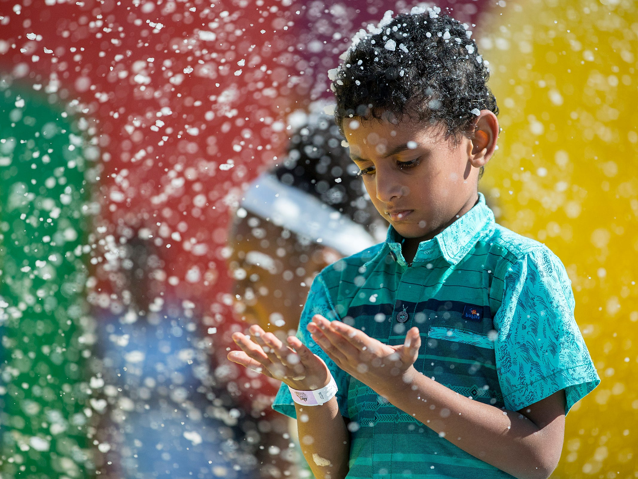 Sanjiv Balaji, 5, is covered in foam at the Big Bounce America inflatable attraction at Waterman's Family Farm in Indianapolis, Friday, Sept. 14, 2018. The world's largest bounce house covers 10,000 square feet and will be in Indy though September 16.