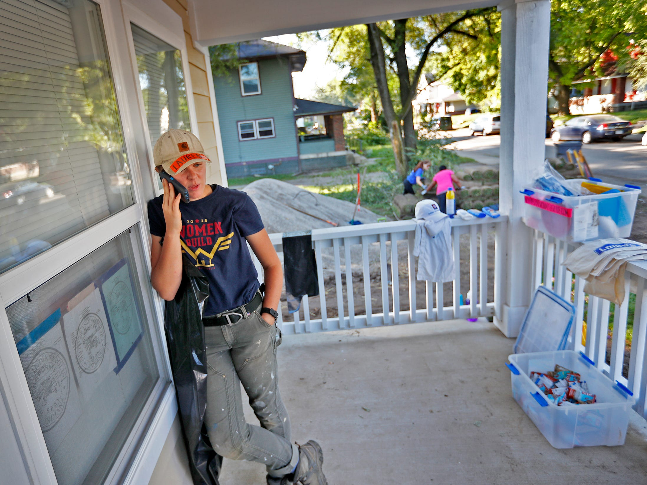 Construction superintendent Lauren Wigton takes a call at a Habitat for Humanity home, during the 10th Annual IU Health Day of Service, Friday, Sept. 13, 2018.  Wigton is the first woman superintendent for a Habitat for Humanity home in Greater Indianapolis.  IU Health team members donated time and effort building and finishing a Habitat for Humanity home in the 3700 block of Kenwood Ave. For 22 days, with partner volunteers, over 250 members of the IU Health team have donated more than 1680 hours at the house that will become the new home for the Ndatira family.