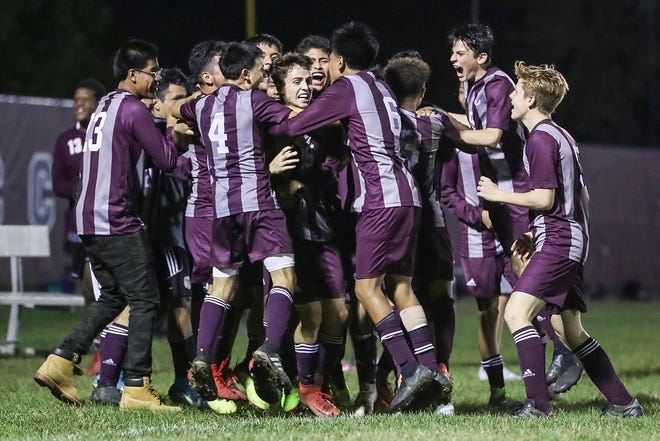 Lawrence Central Bears Max Allen (15) celebrates his goal with teammates, putting the team ahead of Pike 2-1, at Lawrence Central High School in Indianapolis, Thursday, Sept. 13, 2018. Lawrence Central won on the team's senior night, 2-1.