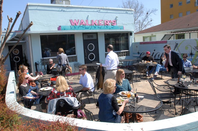 A crowd of diners enjoy lunch under clear-blue skies at Walker's Drive-in in Jackson's Fondren District on Wednesday.